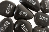 Image of inspirational words on pebbles