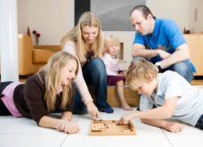 Image of family playing backgammon
