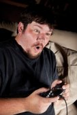 Young man intensely playing video game
