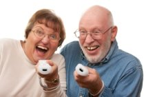 Older couple playing Wii video game
