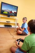 Two kids playing racing video game together